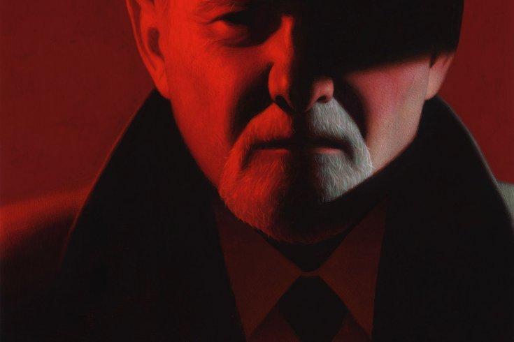 Man in hat under red lighting