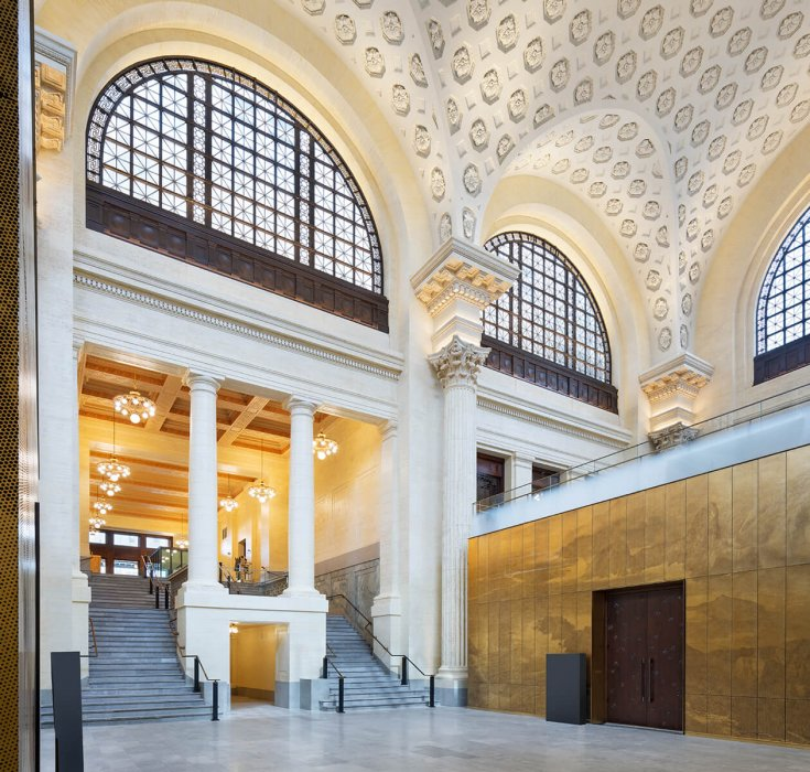 A lobby area with vaulted yellow and gold ceilings.