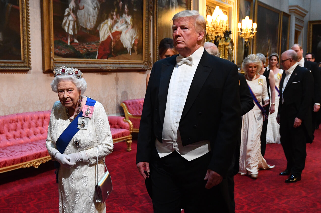 Donald Trump in a formal tuxedo, walking with the Queen of England.