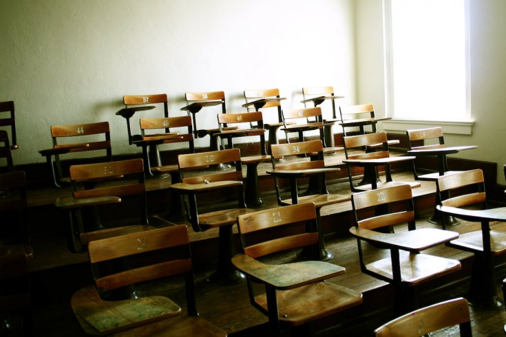 wooden seats in a classroom