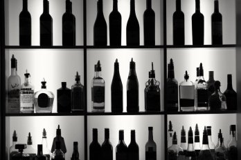 silhouette of several wine and liquor bottles