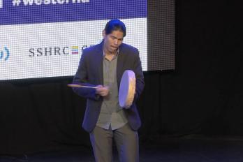 Man performing at Walrus Talks event