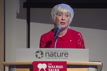 Woman speaking in front of crowd at the walrus talks