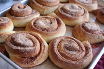 cinnamon rolls on a baking sheet