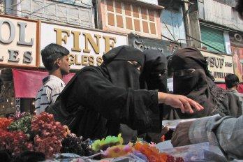 Photograph of Three Women Wearing Niqabs Shopping