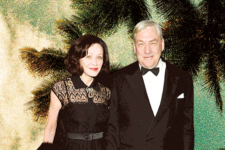 A photograph of Barbara Amiel and her husband, Conrad Black, in formal attire. The background shows a couple of palm trees.