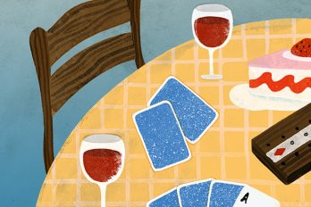 A brown kitchen chair seated at a round table, covered in a yellow checked tablecloth. On the table are two glasses of wine, a slice of cake, and several face-down playing cards with the ace of spades facing up.