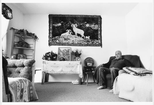 August Brown sits in the living room of his Telegraph Creek home. Brown worked as a ranch hand for a big-game outfitter for most of his life.
