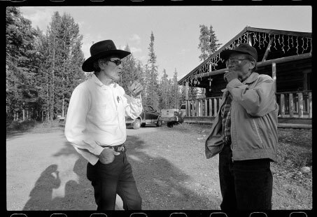 Pat Edzerza, at left, chats with Bobby Quock in the front yard of Edzerza's Dease Lake home.