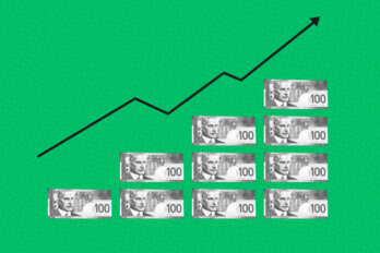 Rising stacks of dollar bills with a graph line increasing