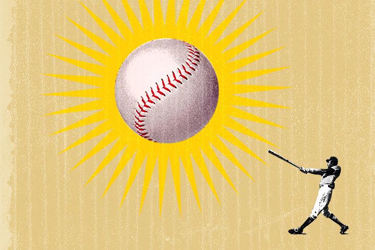 A baseball player hitting an oversized ball