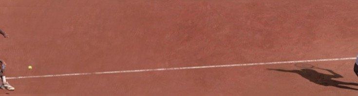 man serving a tennis ball