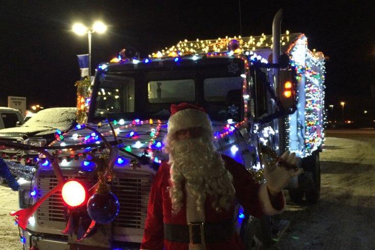 Santa posing in front of school bus