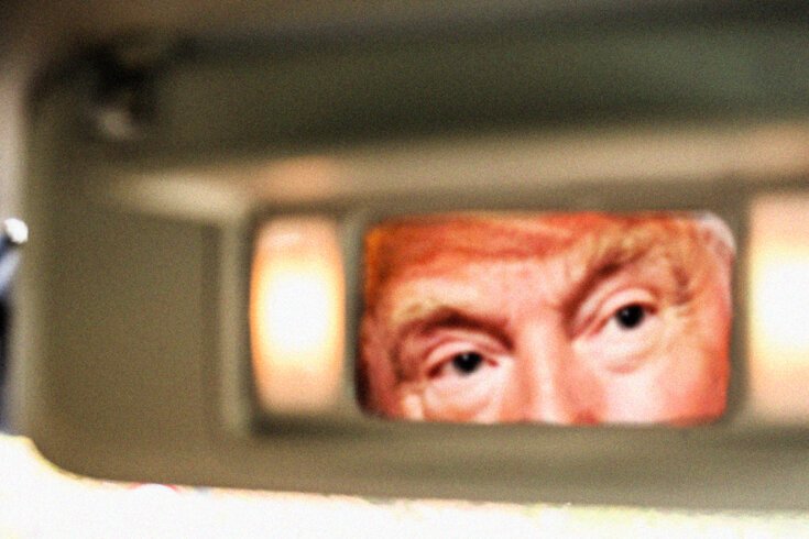 Photo of Donald Trump's eyes and forehead looking through a rectangle.