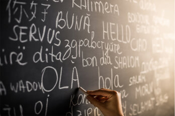 A chalkboard featuring many words in different languages