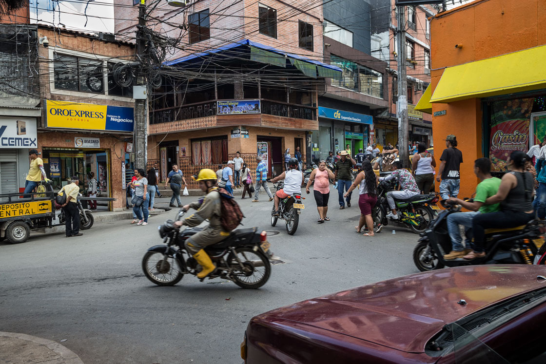 A miner on a bike speeds through an intersection near the central plaza.