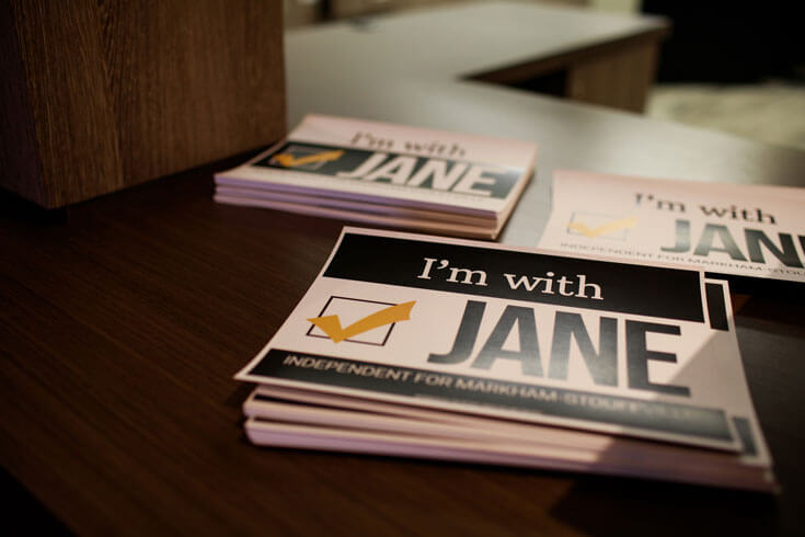 A stack of flyers that read I'm with Jane
