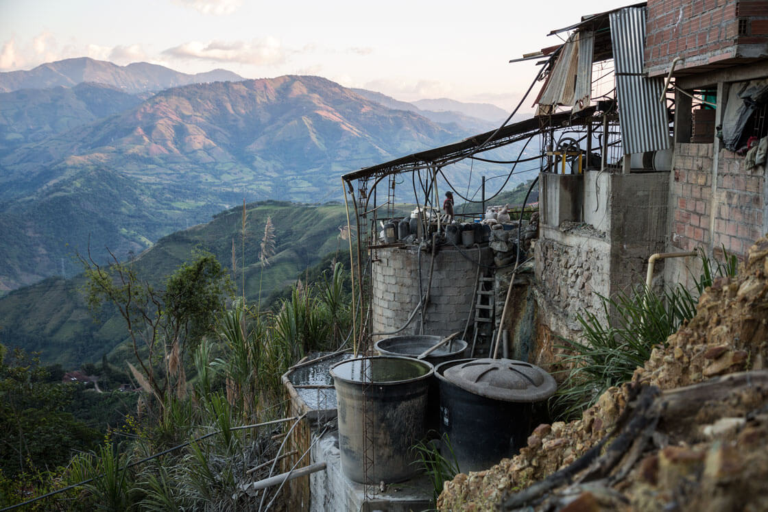 An ore refinery sits on a mountainside.