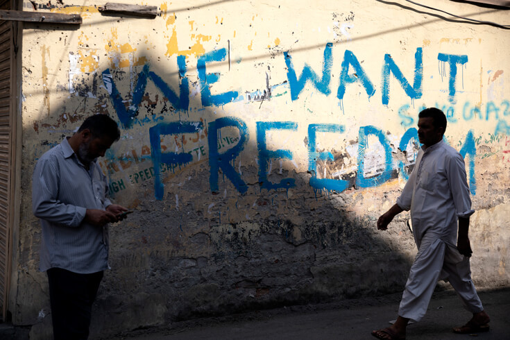 "Graffiti on the wall in Srinagar reading ""We want freedom."""
