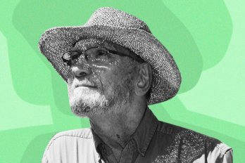 Photo of the poet, George Amabile, wearing a sun hat and looking toward the sky. The photo is in black and white; the background is various shades of green.