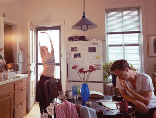woman stretching inside kitchen
