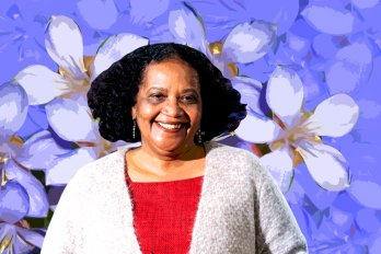 Photo of the poet Lorna Goodison against a violet floral backdrop