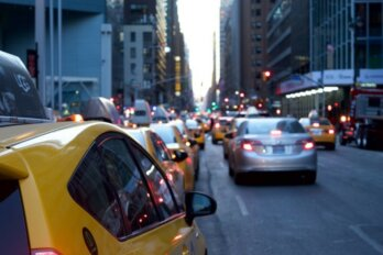A photo of cars in traffic.