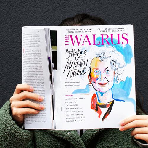 Woman holding Walrus magazine