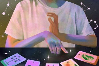 Illustration of a young woman in a white t-shirt looking at four tarot cards laid out on the table in front of her.