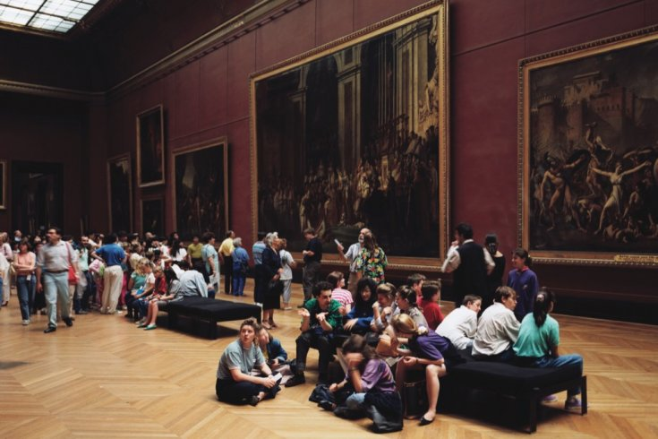 people sit in an art gallery