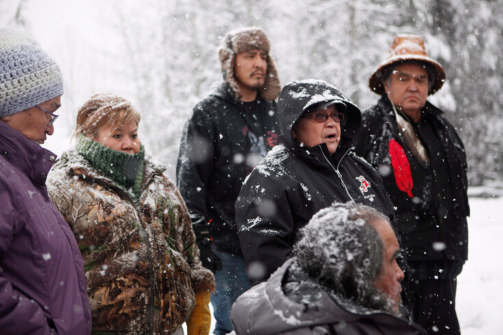 Unist'ot'en Chief Doris Rosso speaks to supporters of the Unist'ot'en camp and Wet'suwet'en people as they gather around a camp fire off a logging road near Houston, B.C.