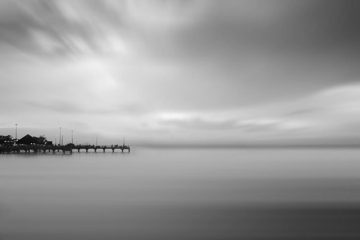 Grayscale Photograph of a Pier