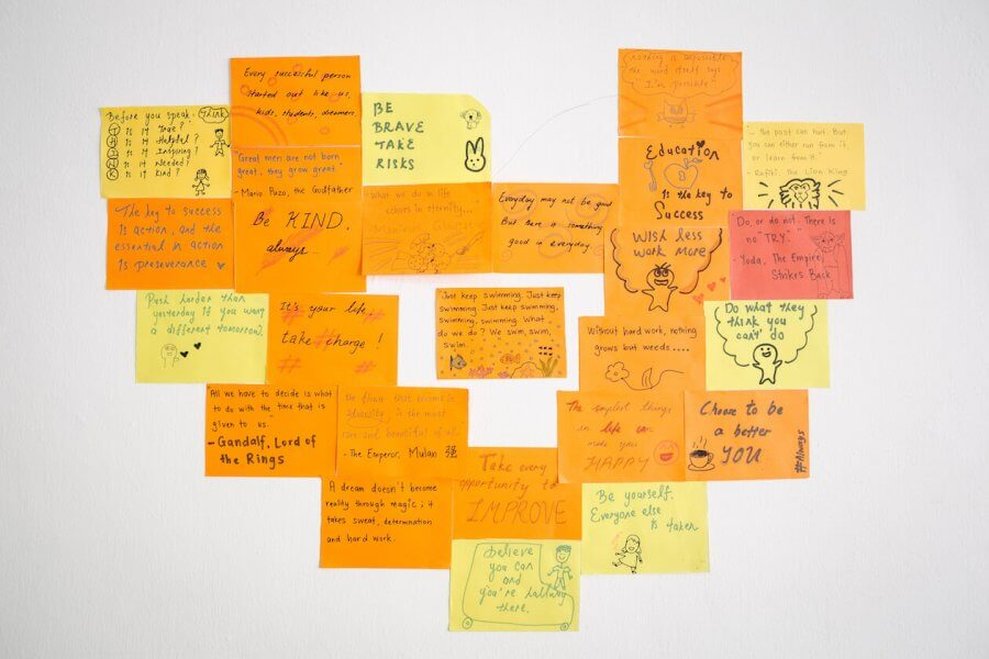 Closeup of sticky notes with handwritten messages