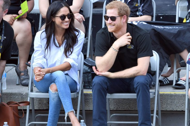 Prince Harry and Meghan Markle sitting on chairs at invictus games
