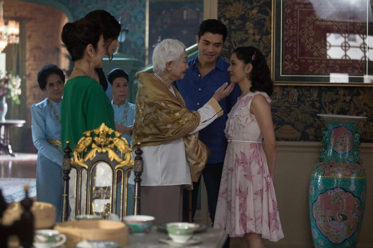 old woman looking at a young woman in a scene from crazy rich asians