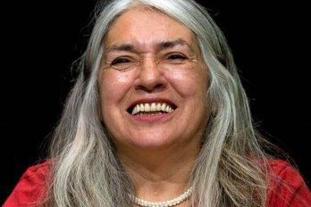 Woman wearing red shirt smiles