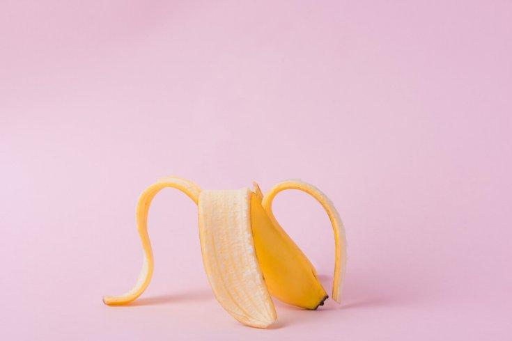 A banana peel on a pink backdrop