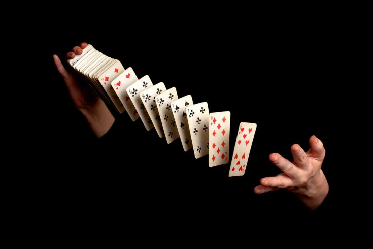 hands throwing and shuffling playing cards