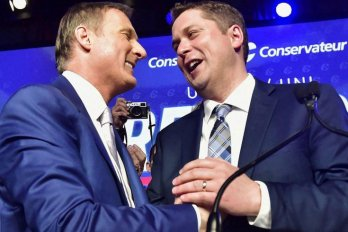 Maxime Bernier and Andrew Scheer greet each other at the Conservative Party's leadership convention.