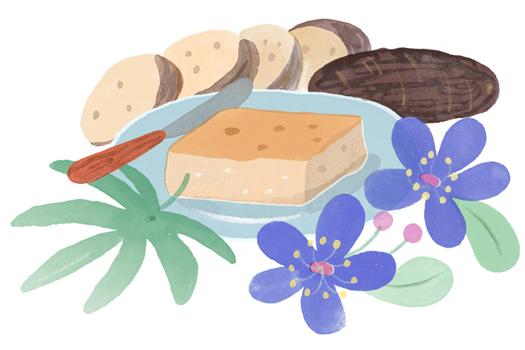 Illustration of several plates containing cassava-based dishes like pie and sliced root. The plates are garnished with purple and green flowers.