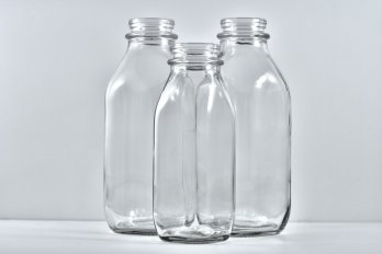 Three empty milk bottles