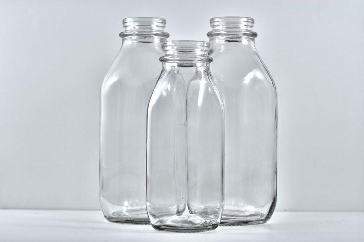 Three empty milk bottles