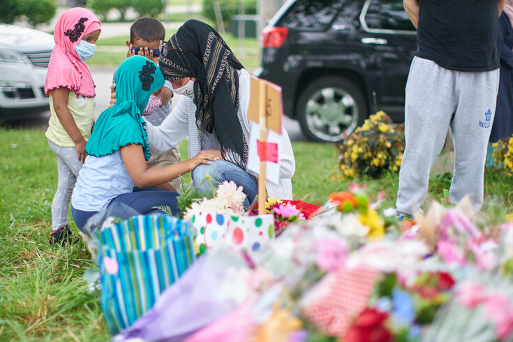 A woman speaks with her daughter at the scene of Sunday's hate-motivated vehicle attack in London, Ontario