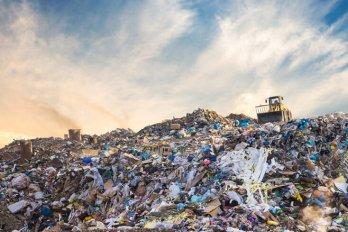A huge pile of garbage at a garbage dump.