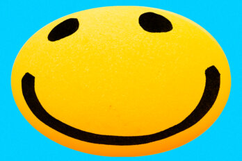 A large, yellow smiley face with an excessive grin.