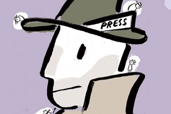"Man wearing a hat that says ""Press"""