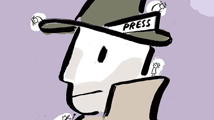 "Man wearing a hat that says ""Press"""