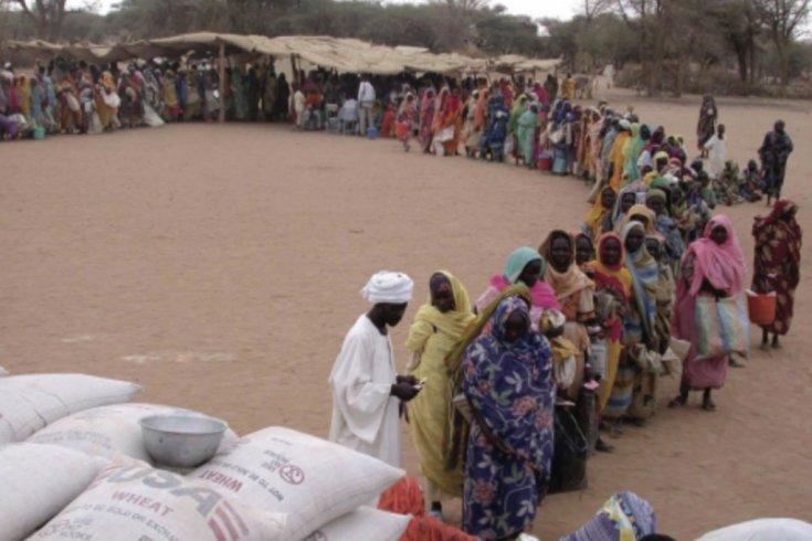 women standing in a line in rwanda