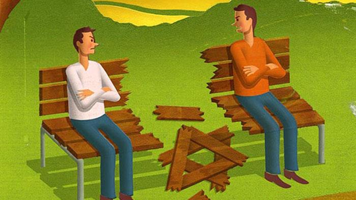 Two men talking on a broken bench