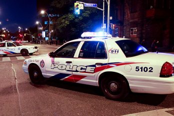 A Toronto Police car in the middle of the road